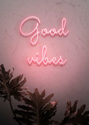 Neon red good vibes on a wall