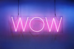 """Neon shine electricity fluorescent sign """"Wow"""" concept illuminated vintage retro club glow icon logo text light WOW billboard signboard trend funny entertaining emotion nightlife in pink blue colors"""