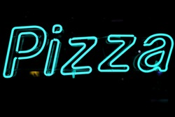 neon shining signboard with word pizza in blue at night