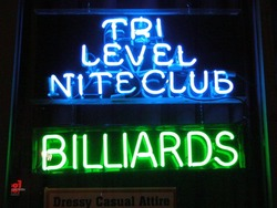 Neon sign announcing niteclub