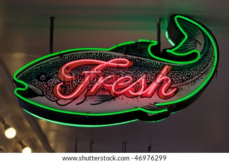 Neon sign for fresh fish for sale at a market no for Fish neon sign