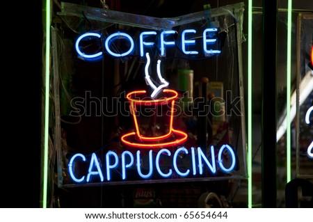 Neon sign in a delicatessen window, New York City - stock photo