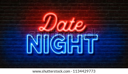 Neon sign on a brick wall - Date Night #1134429773