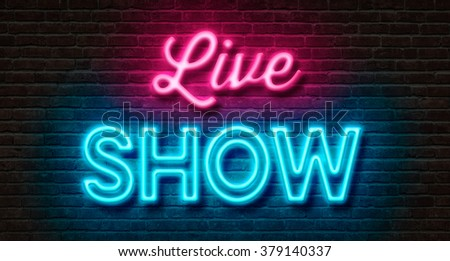 Neon sign on a brick wall - Live Show #379140337