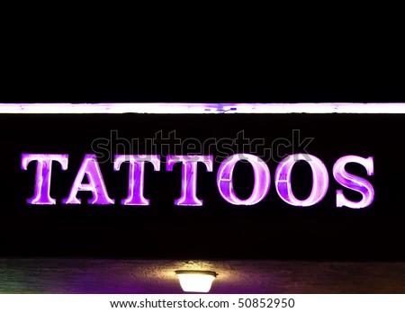 neon tattoo sign. stock photo : Neon sign