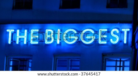 neon sign the biggest - stock photo