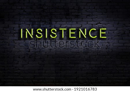 Neon sign with inscription insistence against brick wall. Night view Stock photo ©