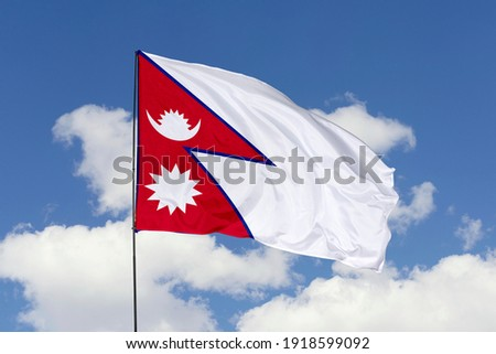 Nepal flag isolated on the blue sky with clipping path. close up waving flag of Nepal. flag symbols of Nepal. Photo stock ©