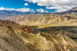 Nepal - Upper Mustang -  View on Himalayian mountains en route from Dhakmar to Lo Gekar