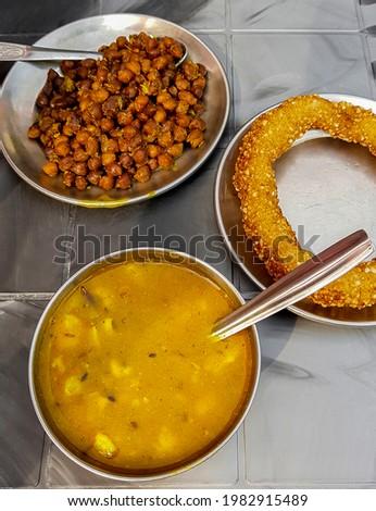 Nepalese food breakfast with Sel Roti and chickpeas. Ring Road in Kathmandu, Nepal. Stock fotó ©