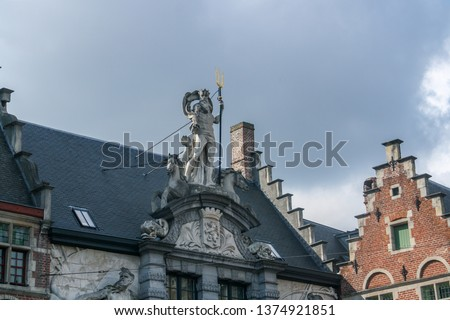 Neptune on top of the Old Fish Market in the Old Market Square (Sint Veerleplein Square), Ghent, Belgium. Neptune keeps watch over the Scheldt (male) and the Lys (female). #1374921851