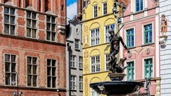 Neptune's Fountain, in the center of Dlugi Targ (the Long Market) in Gdansk, Poland. Statue of Roman god erected in 1549 is a symbol of the city and its most recognizable landmark.