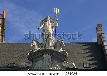 Neptune statue on the house in Gent, Belgium
