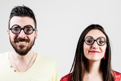 nerd couple made by a nerd man and nerd woman with very thick eyeglasses
