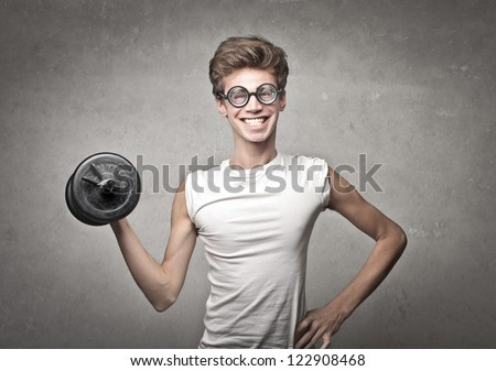 Nerd guy raising a dumbbell