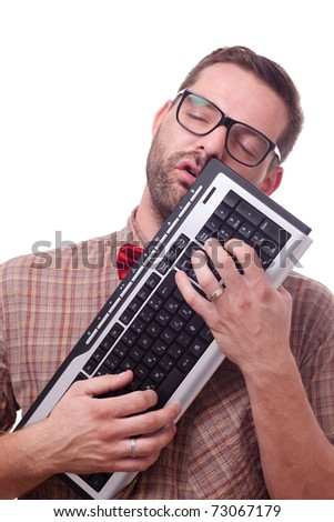 Nerd in love with his keyboard