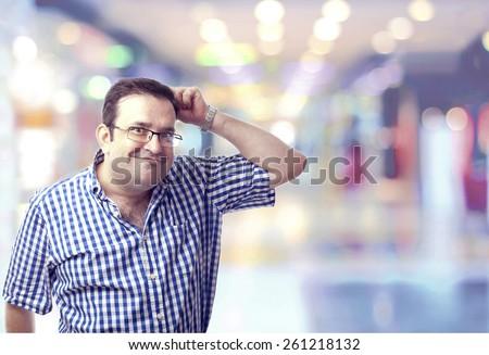 nerd man scratching head like a monkey in the shopping center