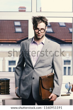 Nerd or brainiac wearing classic jacket. Academic style and business concept. Serious man or professor with bristle in nerd glasses. Man with briefcase isolated on white background.
