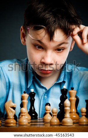 Nerd play chess on a black  background