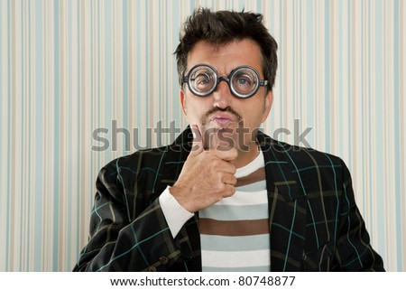 nerd silly myopic man with glasses thinking doing funny gesture with retro mustache - stock photo