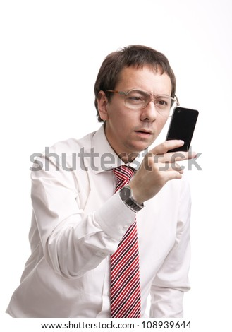 Nerdy businessman holding a smartphone and trying to read a message