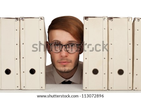 nerdy businessman is stuck between the files.isolated on white