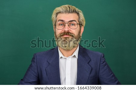 Nerdy genius. Genius man green chalkboard. Genius teacher wear glasses. Brainbox. School and education. Private teaching. Private lesson. I have nothing to declare except my genius.