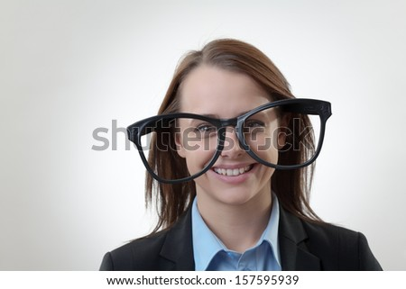 Nerdy office woman wearing silly funny large glasses