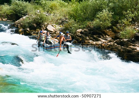 NERETVA, BOSNIA - 25 JULY: Unidentified teams practice at the first day of training for World Rafting Championship in the canyon of River Neretva on July 25, 2009, Bosnia and Herzegovina. - stock photo