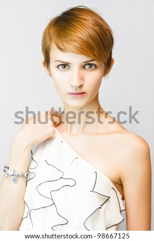 Nervous and apprehensive beautiful young woman with mesmerising eyes looking stunned and surprised during a fashion model photoshoot