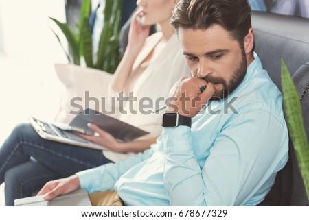 Nervous bearded guy waiting in queue for job talk indoor #678677329