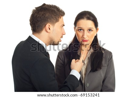 Nervous boss argue nd pointing to a sad employer woman isolated on white background