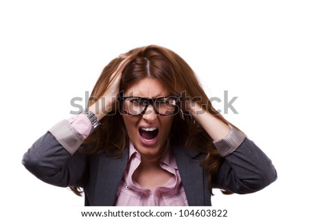 Nervous breakdown portrait of a stressed out businesswoman holding her head and pulling her hair in anger - stock photo
