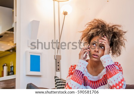 Nervous girl on mobile phone. Frowning young woman talking on telephone, something is wrong, problem.. Young Woman Heard Bad News