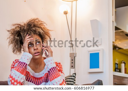 Nervous girl on mobile phone. Frowning young woman talking on telephone, something is wrong, problem. Young Woman Heard Bad News
