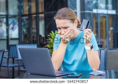 Nervous horrified confused young woman, stressed worried lady having problem with paying, buying online, payments with credit blocked bank card, looking at screen, monitor of laptop. Internet fraud ストックフォト ©
