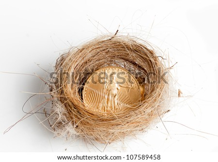 Nest egg of golden eagle coin in woven birds nest as concept of wealth
