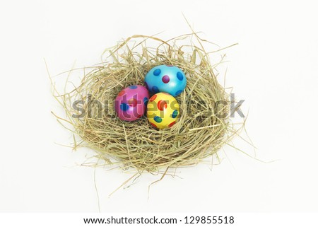 Nest full of colorful Easter Eggs from above - stock photo
