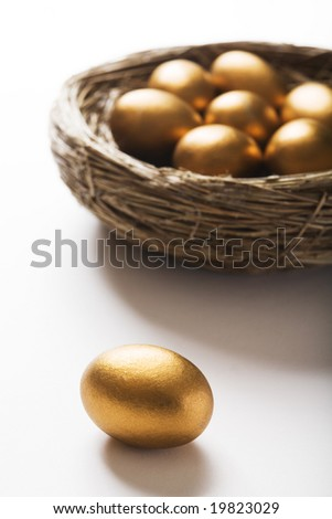 Nest Of Golden Eggs With Single Egg In Foreground
