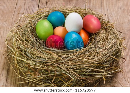 Nest with Easter eggs on the background boards - stock photo
