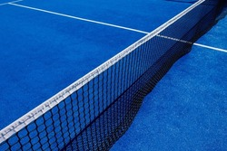 Net on a blue paddle tennis court