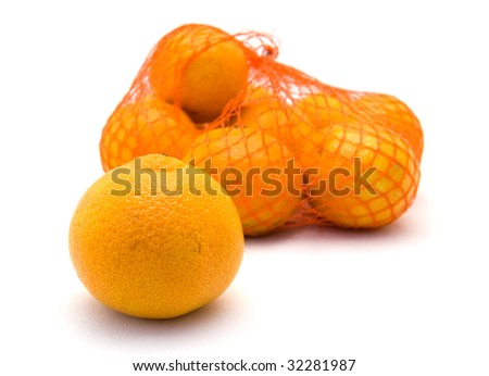 Net with fresh mandarins with one lying in the front