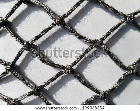 net with shadow made of flexible rope with rhombus shape #1199338354