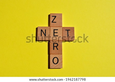 Net Zero, word in crossword form isolated on yellow background Stock fotó ©