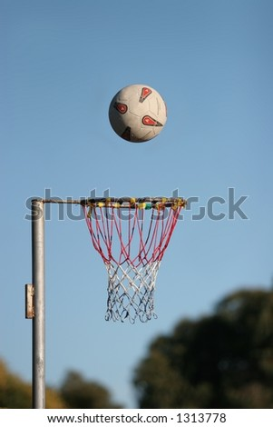 Netball about to go into the goal, on a fine autumn morning at Lincoln, New Zealand.