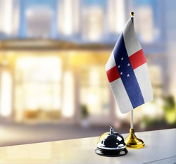Netherlands Antilles flag on the reception desk in the lobby of the hotel