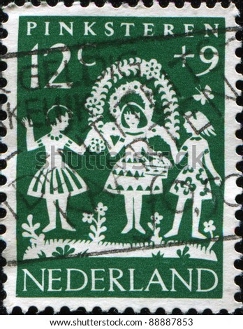 NETHERLANDS - CIRCA 1961: A stamp printed in Netherlands honoring Child Welfare, shows Whitsuntide, circa 1961