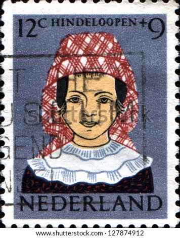 NETHERLANDS - CIRCA 1960: A stamp printed in  Netherlands shows Girl in Regional Costume, Hindeloopen, circa 1960