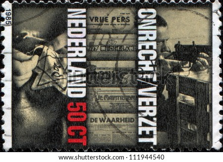 NETHERLANDS - CIRCA 1985: A stamp printed in  Netherlands shows Star of David, Illegal Newspapers and Rifle Practice (Resistance Movement),  40th Anniversary of Liberation, circa 1985