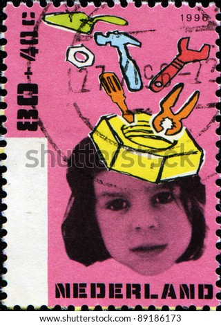 NETHERLANDS - CIRCA 1996: A stamp printed in the Netherlands shows Child Welfare, Tools and girl, series, circa 1996